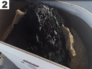 2. Biosolids are placed on top of the chips in the rotomix truck.